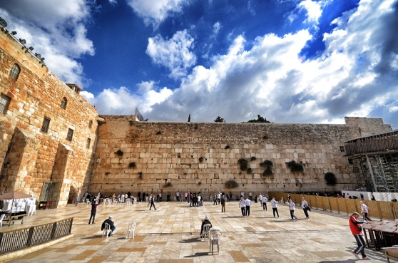 The Wailing Wall, notice the people at the wall in prayer.